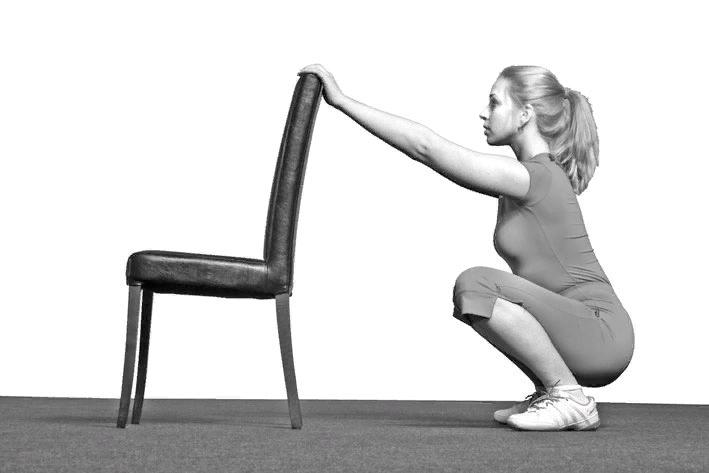 Приседания со стулом.